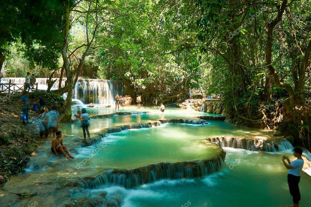Фотообои Luang Prabang. Laos. 04.20.2019. People visit Kuangsi Waterfall.