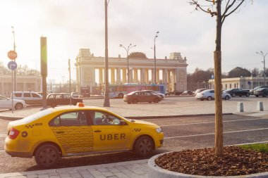 MOSCOW, RUSSIA - NOVEMBER 13 , 2017: Yellow cab UBER in Central Moscow, street the Crimean shaft, next to the Central house of artists and Gorky Park