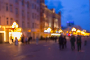 Moscow, Russia, Old Arbat street in the evening with bokeh and blur effect, tourists and locals walking on the street