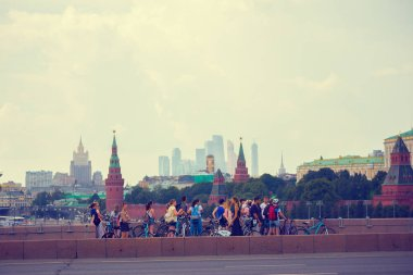 MOSCOW; RUSSIA - AUGUST; 4; 2018: Tourists and locals walk on the bridge near the Moscow Kremlin on the background of the business center Moscow city