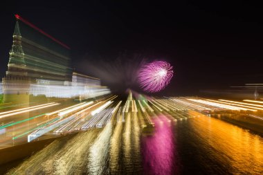 Moscow Kremlin at night with colorful fireworks with motion and zoom effect