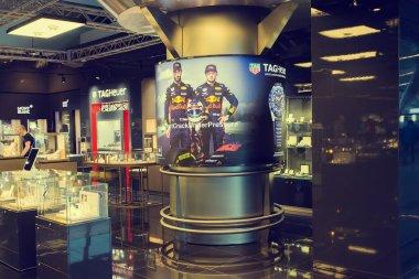 MOSCOW, VNUKOVO, RUSSIA - SEPTEMBER 16, 2018: Daniil Kvyat and Dan Ricciardo of the red bull team on advertising in Duty free at Vnukovo airport in Moscow