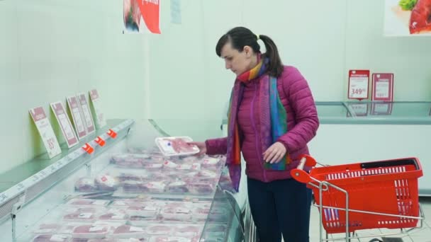 Young Woman Shopping for Meat in a Supermarket