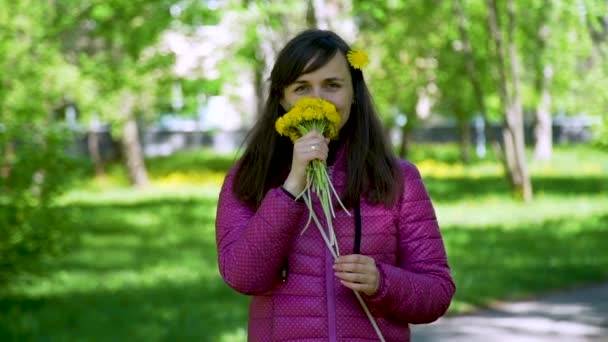 Young Woman Sniffing Yellow Dandelions