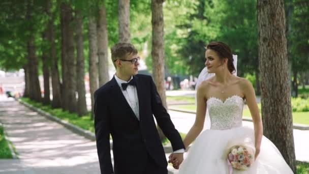 Wedding Couple Walking in a City Park