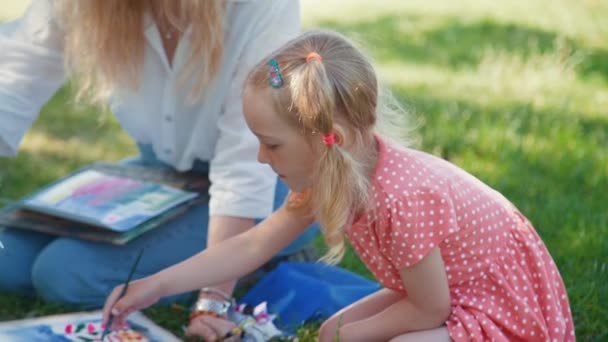 Child Drawing with Watercolor Outdoors