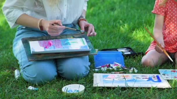 Little Girl and Teacher Drawing Together Outdoors