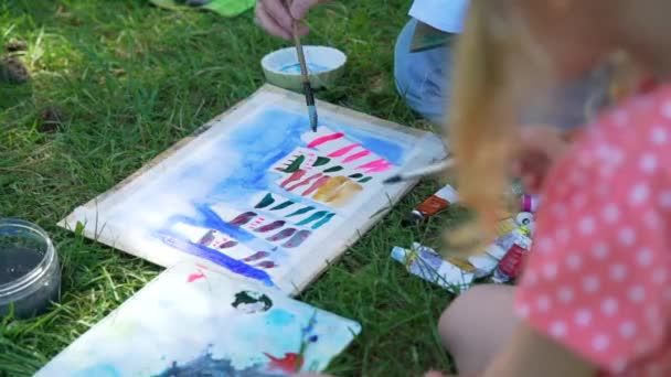 Woman and Little Girl Painting Picture in a Park