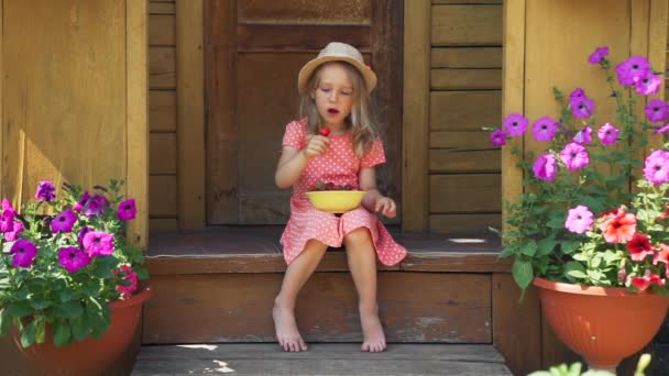 Little Girl Eating Fresh Strawberry in Summer Day