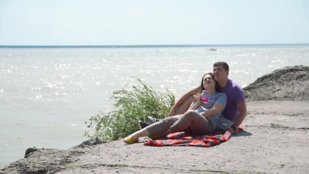 Young Couple Relaxing on the Stone Beach