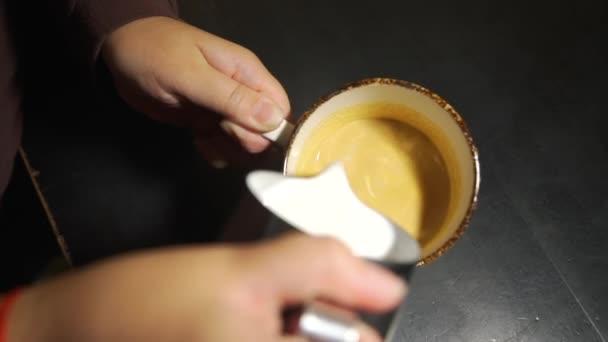 Barista Pouring Steamed Milk into Coffee Cup