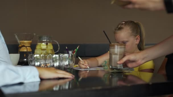 Waitress Bringing Milkshake and Iced Lemonade