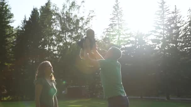 Father Throws Up Baby Girl in Nature