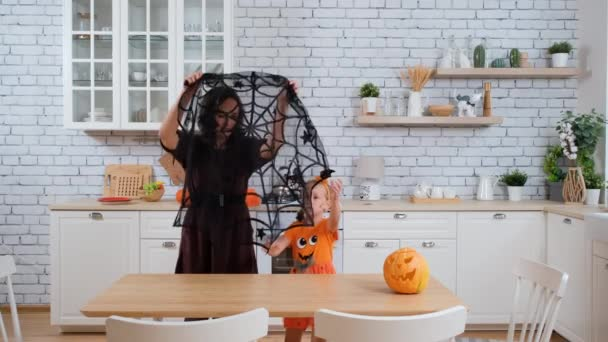 Mother with Daughter Decorate Table for Halloween
