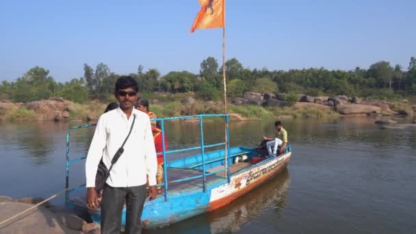 People are transported by boat to the other side of the river.