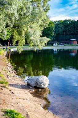 View of the ponds and rotunda in Dubki park. Timiryazevsky district of Moscow.