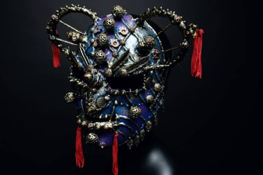 Iron mask with precious stones  on background,close up