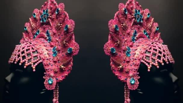 Head of mannequin in creative pink kokoshnick, dark background