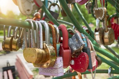 wedding padlock of different colors and shapes in the sun