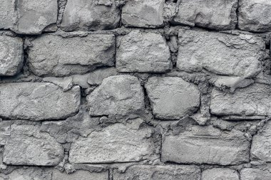 Gray old wall made of aerated concrete blocks