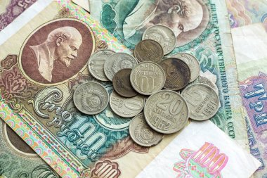 Old vintage money banknotes and coins of former Soviet Union as background