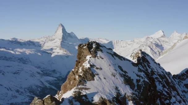 Beautiful Winter Aerial Flight Over Mountain Chain Landscape Swiss Alps. Adventure Hiking. Travel Concept. UHD 4K