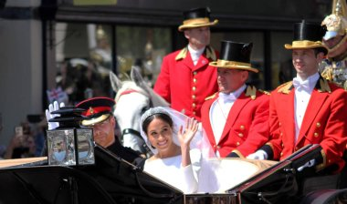 Meghan Markle, Prince harry wedding stock photo - Windsor, Uk - 19/5/2018: Prince Harry & Meghan Markle wedding carriage procession through Windsor then back the Windsor Castle Meghan waving to crowd stock, photo, photograph, image, picture, press,