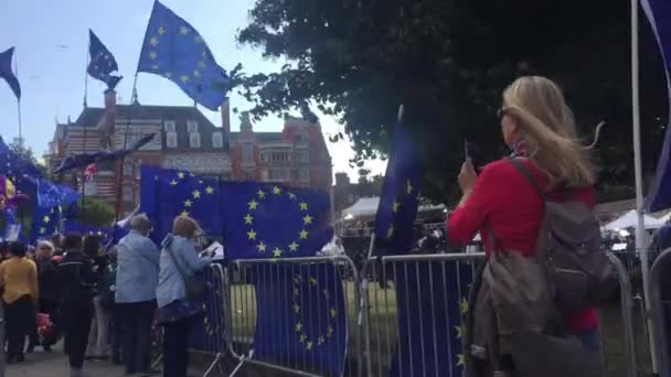 London, UK- Sept 17th 2019: anti Brexit protestors outside Houses of  parliament, camera crews and European union flags - stock footage video