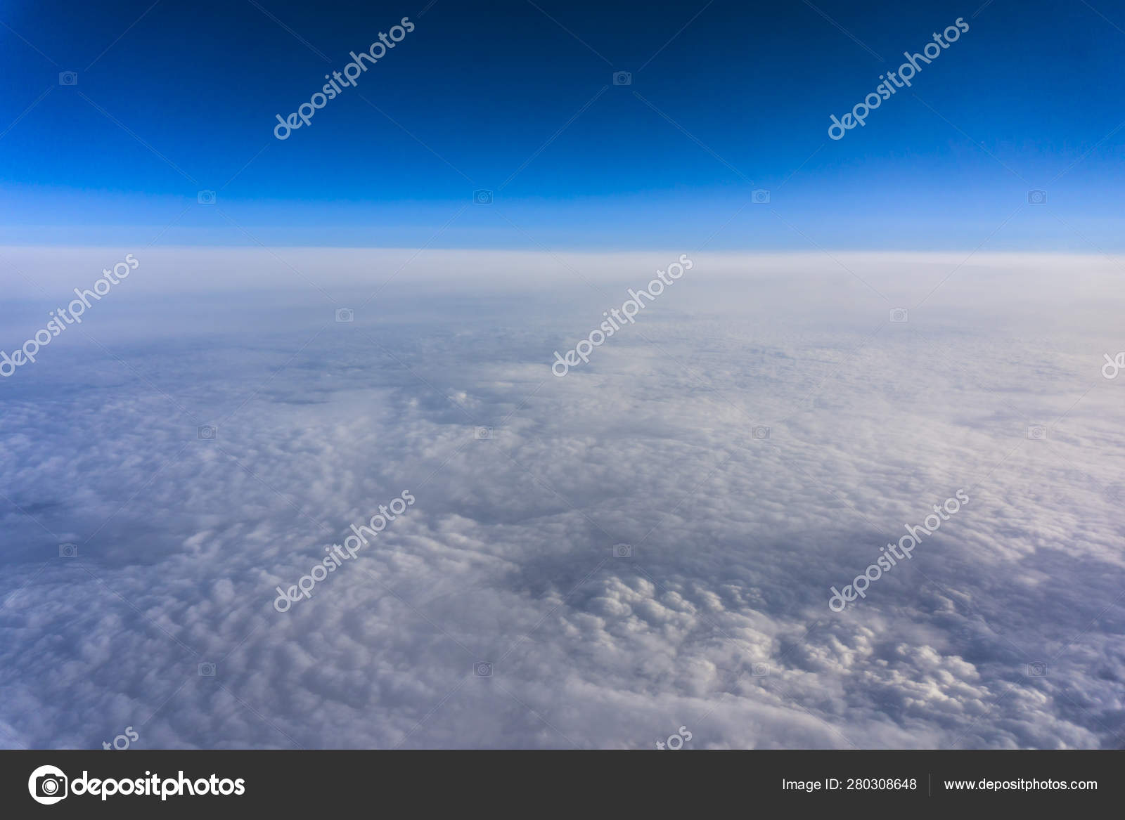Above clouds, view from pilot cabine airplane. Blue sky, white clouds with magic and soft sun light.