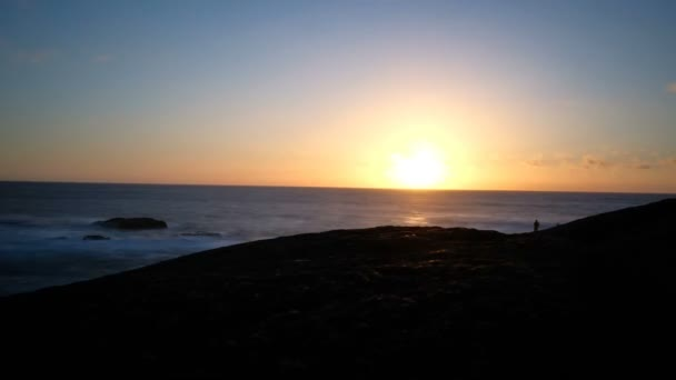 Inspirational Sunset Timelapse on ocean rock coast with people fishing and clouds