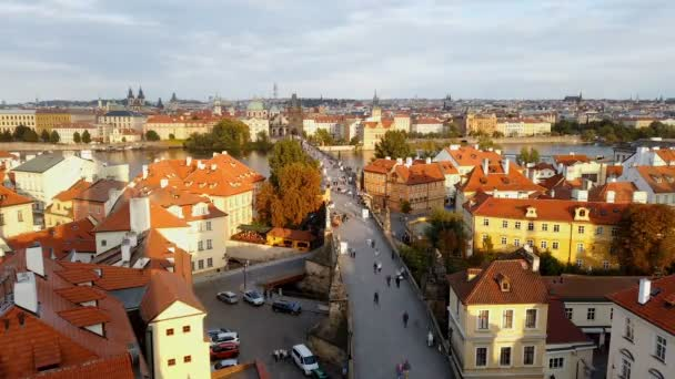 Aerial timelapse of people tourists walking on famous Charles Bridge in Prague