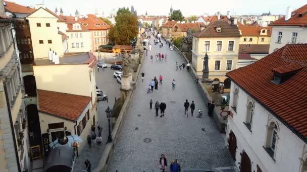 Aerial timelapse of people rush walking on famous Carlo Bridge in Prague center
