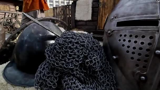Bucharest, Romania - Jule 10, 2018: Several armor, weapons and knight helmets are featured at a medieval fair, in Bucharest, Romania.