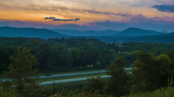 Dusk Setting Next To Interstate 26 With Traffic In Asheville Nc With The Blue Ridge Mountains And Sunset In The Background