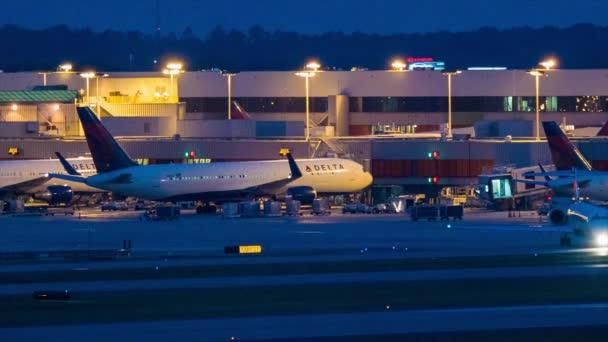 Evening Hartsfield Jackson Atlanta International Airport Terminal Exterior featuring Delta Airlines Passenger Airplanes