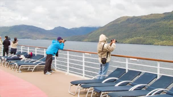 Tourists Cruise Ship Passengers Standing on Open Deck Viewing and Taking Pictures of the Strait of Magellan in South America