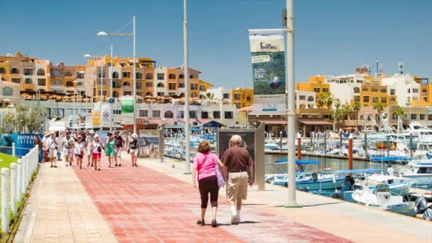 Cruise Ship Passengers Guests Visiting and Exploring Cabo San Lucas Harbor Marina as their Port of Call in the Mexican Riviera with People Walking along the Pier of the Popular Destination