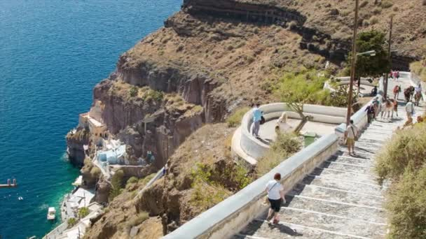 Santorini Greece Tourists and Donkeys on Historical Path Between Coast and Thira Town on a Hot and Sunny Summer Day at the Popular Greek Destination