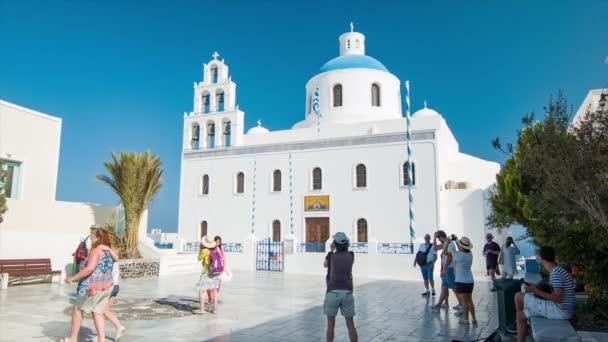 Ekklisia Panagia Platsani Church in Oia Town on Santorini Island Greece with Visiting Sightseeing Tourists at the Historical Greek Landmark