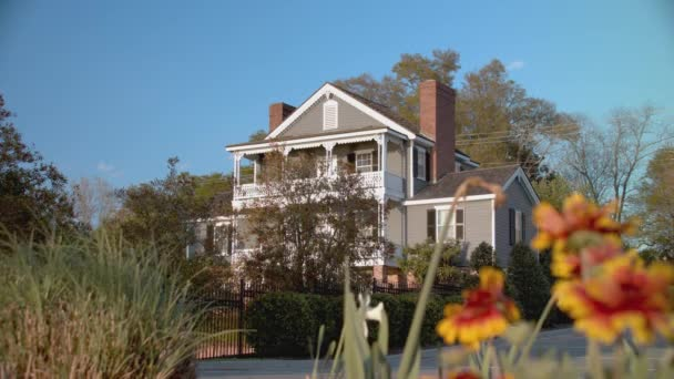 Wilmington NC Home with Southern Charm with Focus Shifting to Colorful Flowers on a Sunny Day in North Carolina