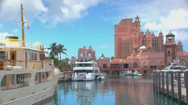 Nassau Bahamas Luxury Boats and Yachts Docked in Atlantis Marina with the Iconic Luxury Resort Hotel Building in the Background