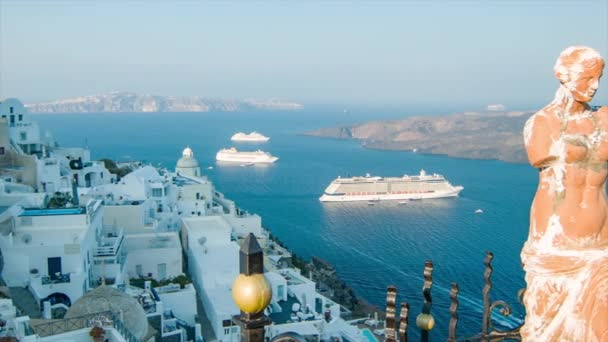 Santorini Greece Picturesque Morning View from Thira Town featuring a Statue and Greek Style Buildings on Top of the Mountain Overlooking the Ocean with Visiting Cruise Ships