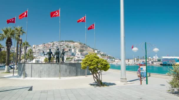 Kusadasi Turkey Turkish Landmark on Ataturk Boulevard with Flags and Statues and Tourists Walking along the Waterfront Port Area of the Popular Mediterranean Cruise Destination