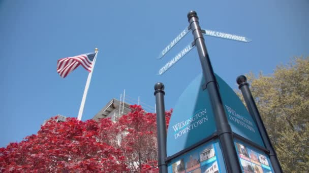 Wilmington NC Tourist Signage with Directions and Information at Thalian Hall in Downtown with an American Flag and a Red Maple Tree