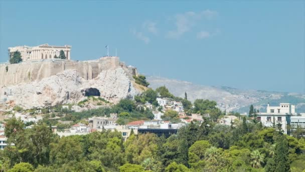 Long Distance Acropolis Hill View in Athens Greece featuring the Ancient Greek Monument Landmarks on a Sunny Day with Blue Sky