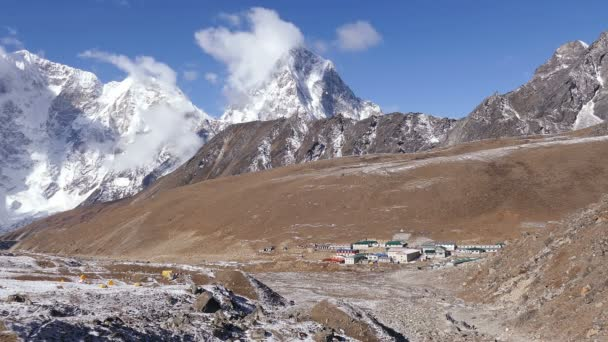 Activity, recreation concept: a group of tourists has a trekking towards the base camp of Everest peak (8848 m). Time lapse.