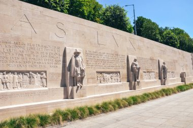 Geneva, Switzerland - July 19, 2019: The Reformation Wall, a monument to the Protestant Reformation of the Church. Depicting numerous Protestant figures. Oliver Cromwell, Roger Williams