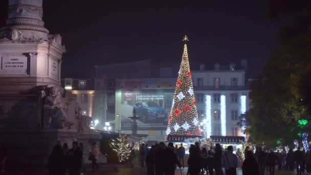 Lisbon, Portugal - 12/26/18: Illuminated Christmas tree decorated with many colored lights, Downtown at praca do Rossio, D Pedro IV, Pedro of Brazil.