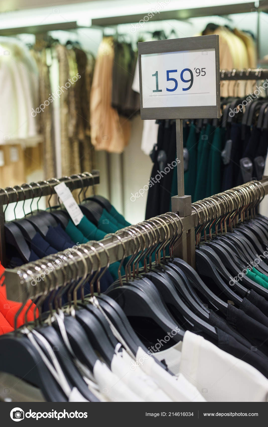 59ede4b96 Fashionable men's and women's clothing on wooden hangers in a modern clothing  store. Stylish clothes for girls and women. Sale and shopping in stores.