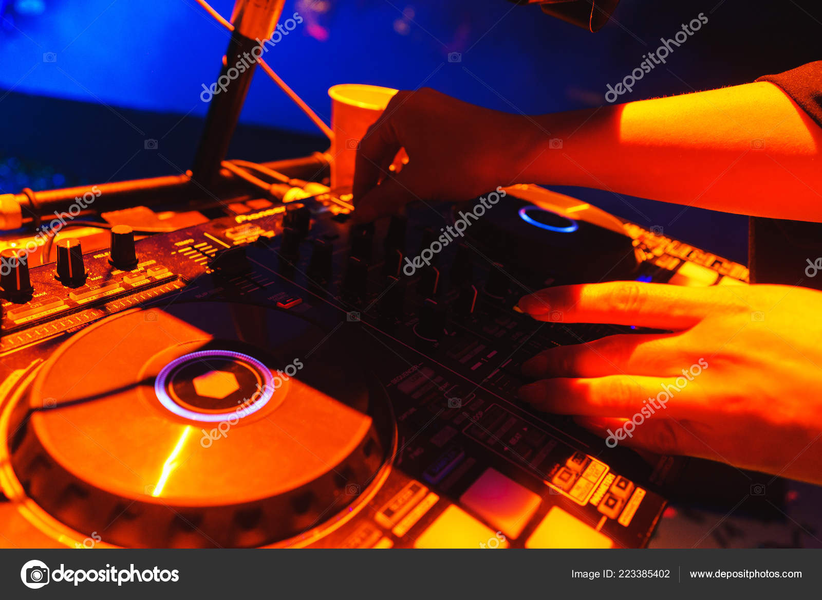 dj hands on a special dj equipment during a performance in a